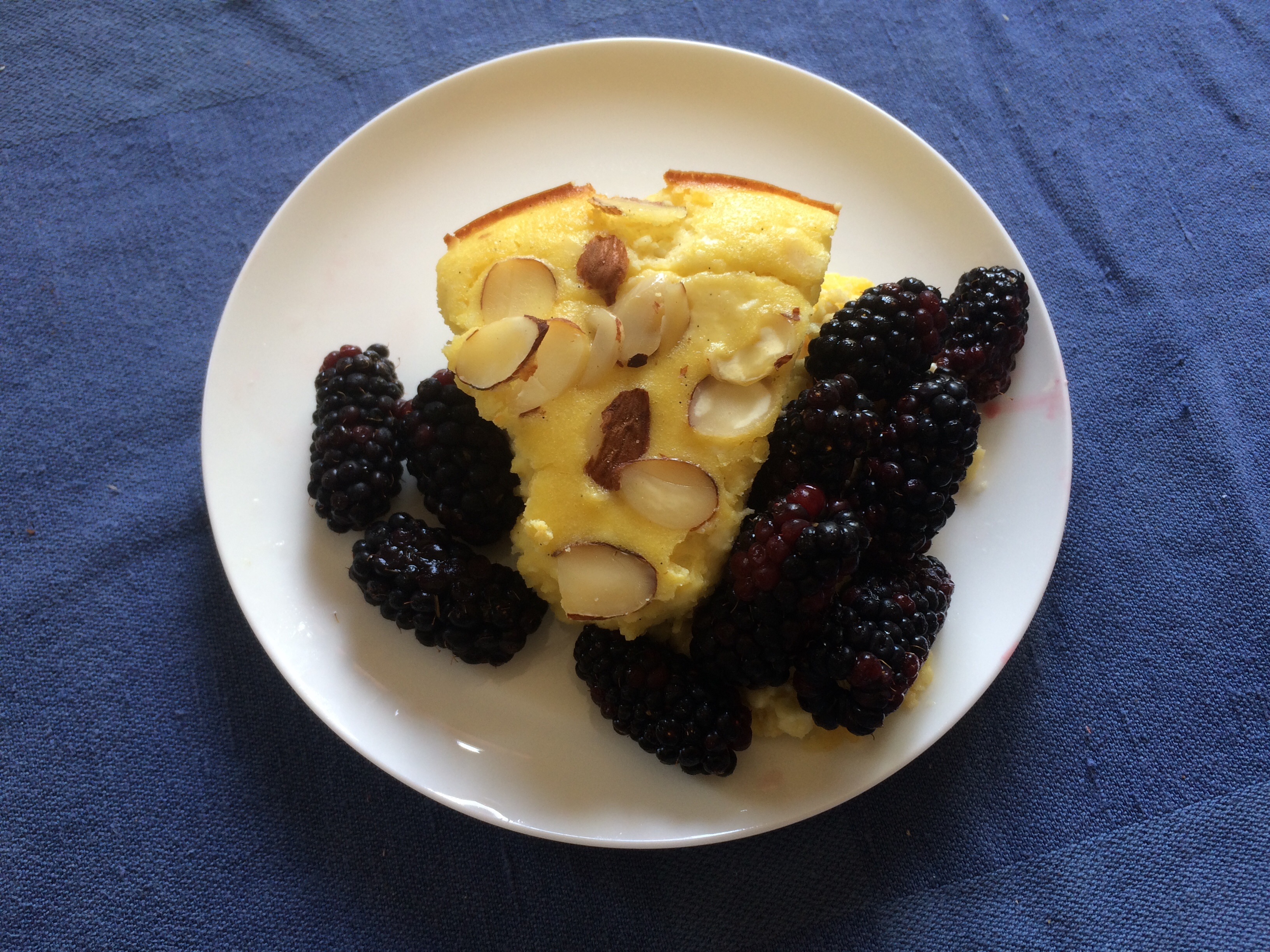 Curd cake and boysenberries